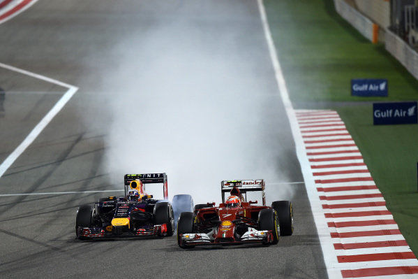 Kimi Raikkonen (FIN) Ferrari F14 T and Daniel Ricciardo (AUS) Red Bull Racing RB10 battle. Formula One World Championship, Rd3, Bahrain Grand Prix, Race, Bahrain International Circuit, Sakhir, Bahrain, Sunday 6 April 2014.  BEST IMAGE