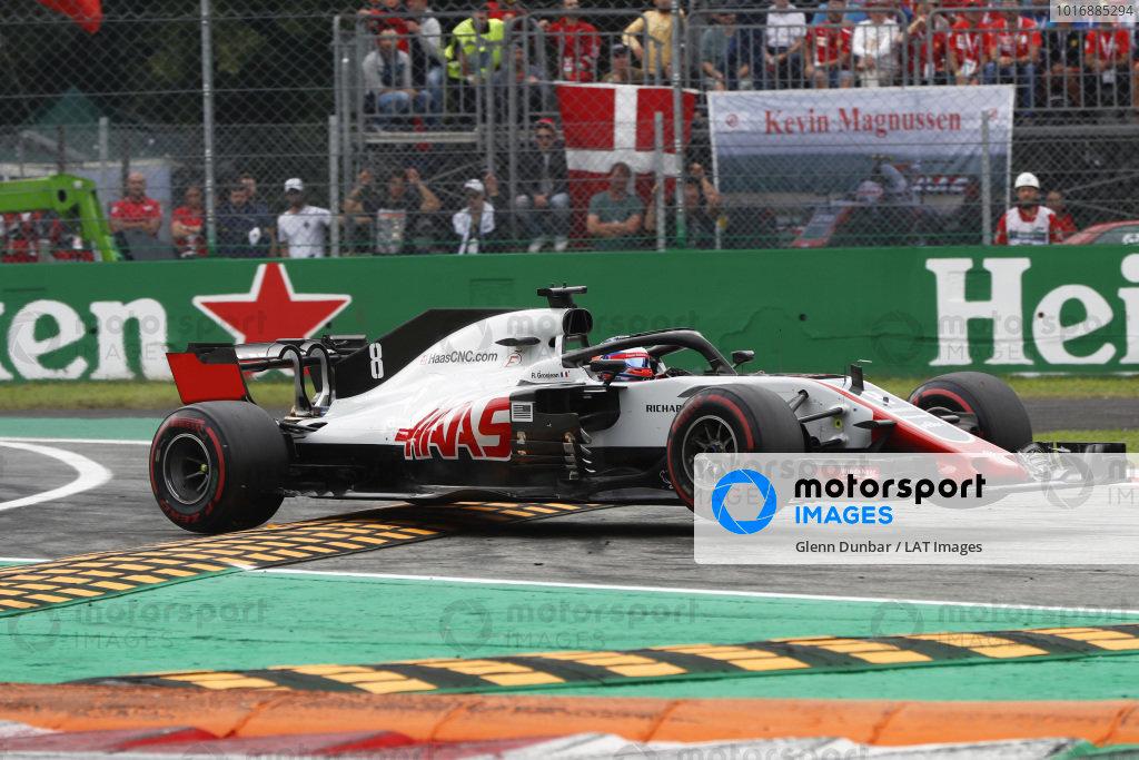 Romain Grosjean, Haas F1 Team VF-18 Ferrari, jumps the kerbs.
