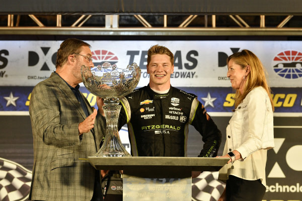 Josef Newgarden, Team Penske Chevrolet celebrates the win in victory lane with trophy
