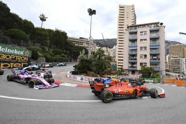 Charles Leclerc, Ferrari SF90, leads Lance Stroll, Racing Point RP19, and Kimi Raikkonen, Alfa Romeo Racing C38