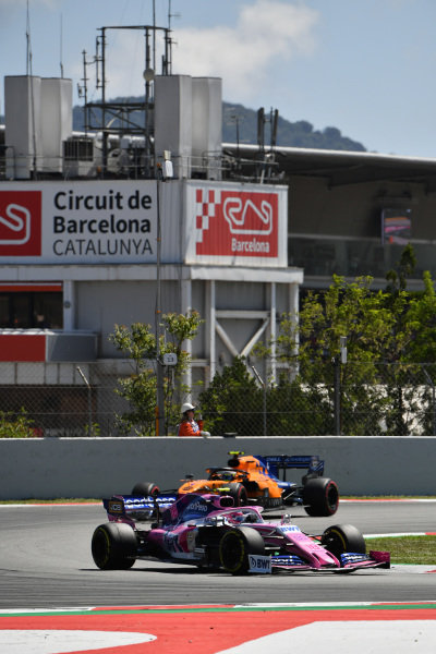 Lance Stroll, Racing Point RP19, leads Lando Norris, McLaren MCL34