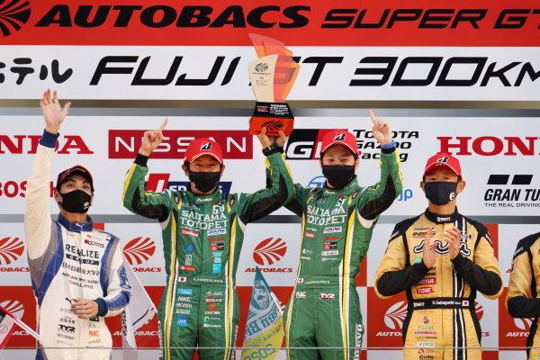 GT300 Winners Hiroki Yoshida & Kohta Kawaai ( #52 SAITAMATOYOPET GB GR Toyota Supra GT ) celebrate on the podium