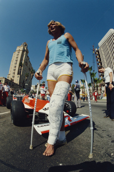 James Hunt with a broken leg from a skiing accident.