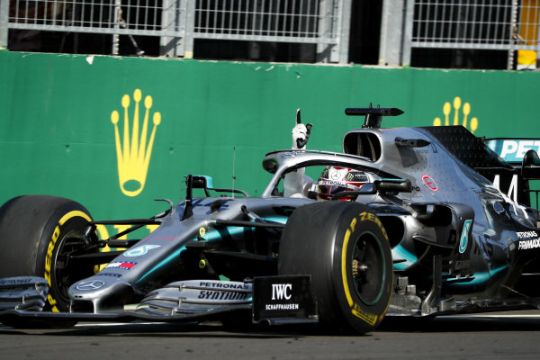 Race Winner Lewis Hamilton, Mercedes AMG F1 crosses the finish line