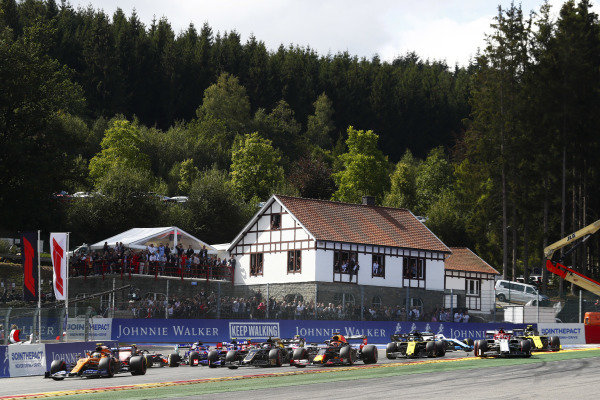 Lando Norris, McLaren MCL34, leads Romain Grosjean, Haas VF-19, Max Verstappen, Red Bull Racing RB15 and the rest of the pack