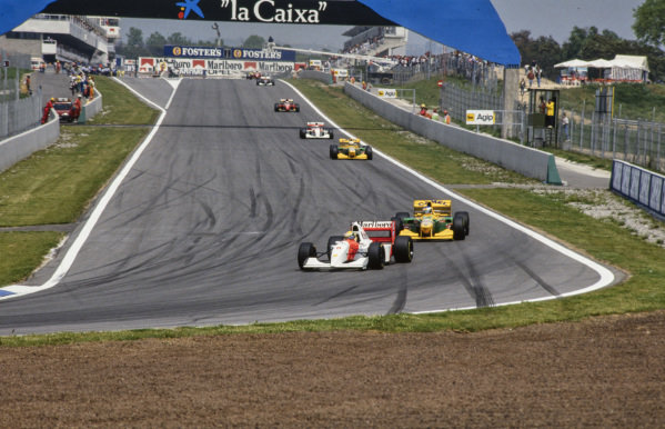 Ayrton Senna, McLaren MP4-8 Ford, leads Michael Schumacher, Benetton B193A Ford, Riccardo Patrese, Benetton B193A Ford, and Michael Andretti, McLaren MP4-8 Ford.
