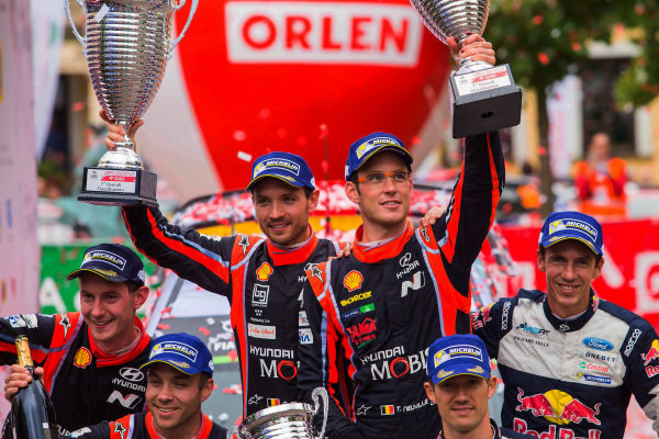 Rally winners Thierry Neuville (BEL) / Nicolas Gilsoul (BEL), Hyundai Motorsport i20 Coupe WRC celebrate with the trophies on the podium at World Rally Championship, Rd8, Rally Poland, Day Three, Mikolajki, Poland, 2 July 2017.