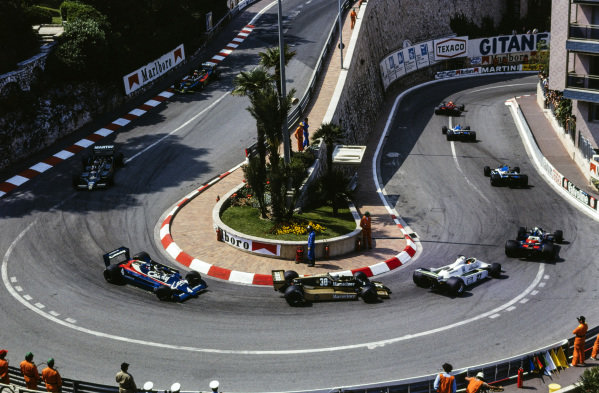 Niki Lauda, Brabham BT48 Alfa Romeo, leads Patrick Depailler and Jacques Laffite, both Ligier JS11 Ford, Didier Pironi, Tyrrell 009 Ford, Alan Jones, Williams FW07 Ford leads Jochen Mass, Arrows A1B Ford and Jean-Pierre Jarier, Tyrrell 009 Ford, Carlos Reutemann, Lotus 79 Ford, and Mario Andretti, Lotus 80 Ford, at the hairpin.