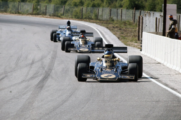 Ronnie Peterson, Lotus 72E Ford leads Emerson Fittipaldi, Lotus 72E Ford and Jackie Stewart, Tyrrell 006 Ford.