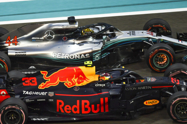 Lewis Hamilton, Mercedes-AMG F1 W09 EQ Power+ with disc barkes glowing and Max Verstappen, Red Bull Racing RB14 battle