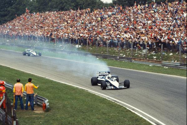 1983 Italian Grand Prix  Monza, Italy. 9-11 September 1983.  Riccardo Patrese, Brabham BT52B BMW, retired, with smoking engine, ahead of team-mate and race winner Nelson Piquet.  Ref: 83ITA12. World Copyright: LAT Photographic