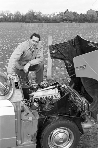 1960, Jack Brabham checks out the new Triumph Herald 948 Coupe