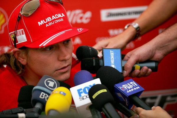 Suzuka Circuit, Suzuka, Japan.1st October 2009.Kimi Raikkonen, Ferrari F60 talks to the media. Portrait.World Copyright: Lorenzo Bellanca/LAT Photographicref: Digital Image ZD2J1094