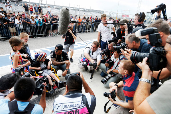 Circuit of the Americas, Austin, Texas, United States of America.  Thursday 22 October 2015. Lewis Hamilton, Mercedes AMG, meets some young fans. World Copyright: Charles Coates/LAT Photographic ref: Digital Image _J5R8304