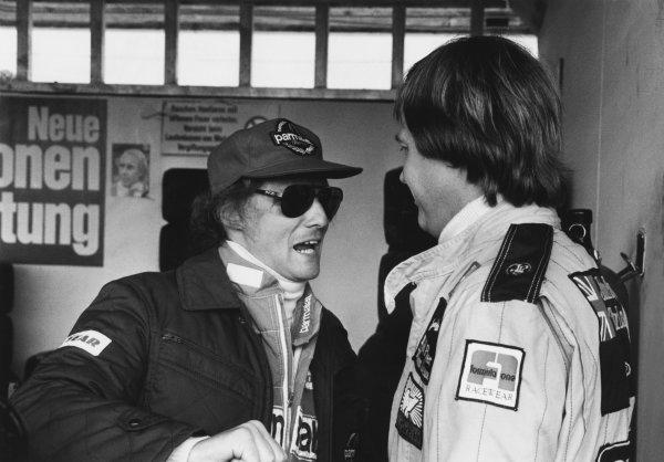 Osterreichring, Zeltweg, Austria. 11th - 13th August 1978. Niki Lauda (Brabham BT46-Alfa Romeo), retired, talks to Ronnie Peterson (Lotus 79-Ford), 1st position, portrait. World Copyright: LAT Photographic. Ref: B/W Print.