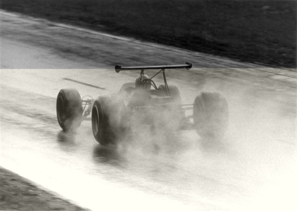 1968 French Grand Prix.Rouen-les-Essarts, France. 7 July 1968.Denny Hulme, McLaren M7A-Ford, 5th position, in the wet, action.World Copyright: LAT PhotographicRef: b&w print