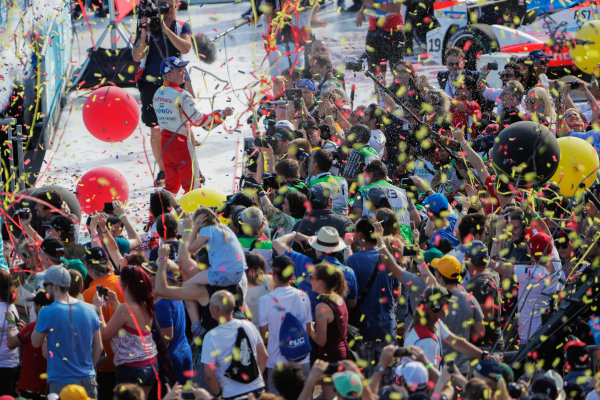 2016/2017 FIA Formula E Championship. Round 8 - Berlin ePrix, Tempelhof Airport, Berlin, Germany. Sunday 11 June 2017. Felix Rosenqvist (SWE), Mahindra Racing, Spark-Mahindra, Mahindra M3ELECTRO, sprays the champagne on the podium. Photo: Zak Mauger/LAT/Formula E ref: Digital Image _56I5863