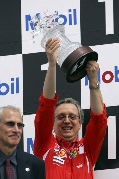 2006 German Grand Prix - Sunday Race Hockenheim, Germany. 27th - 30th July. Paulo Martinelli of Ferrari celebrates with the Constructor's trophy on the podium. World Copyright: Lorenzo Bellanca/LAT Photographic ref: Digital Image ZD2J2105