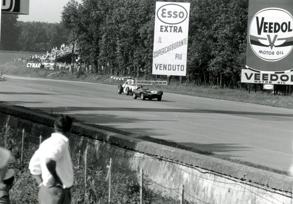 1957 USAC Monza 500.Monza, Italy. Two cars run anti-clockwise around the circuit, action.World Copyright: LAT Photographic.Ref: 7448F #12