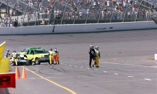 Team Rahal team mates Kenny Brack (SWE) and Max Papis (ITA) walk away from a  high speed accident fifteen laps from the end. Michigan 500, Brooklyn, Milwaukee, USA, 22 July 2001.
