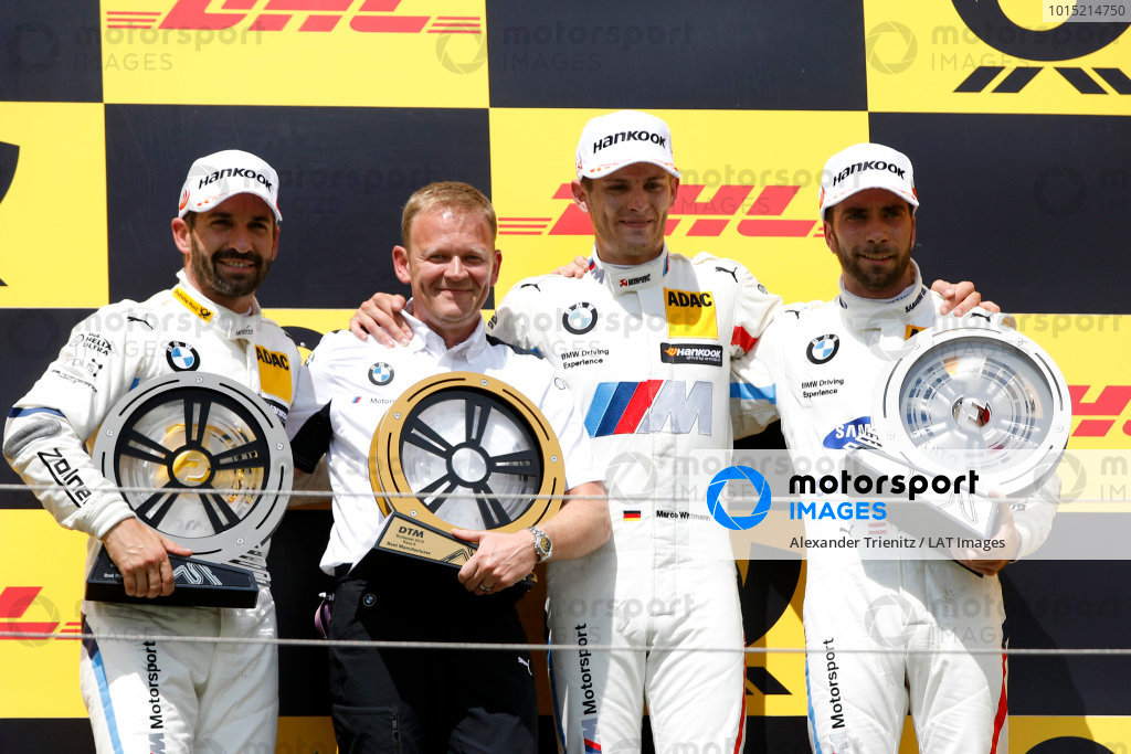 Podium: Race winner Marco Wittmann, BMW Team RMG, second place Timo Glock, BMW Team RMG, third place Philipp Eng, BMW Team RBM, Stefan Reinhold, Team principal, BMW Team RMG.