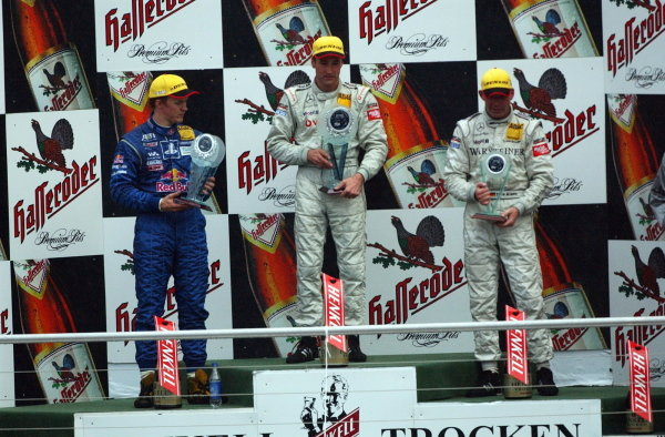 DTM Championship 2002, Round 10 - Hockenheimring, Germany, 6 October 2002 - Podium of the last race of the 2002 season. 1st: Bernd Schneider (GER),Vodafone AMG-Mercedes, centre; 2nd: Mattias Ekstrom (SWE), Team Abt, left; 3rd: Uwe Alzen (GER), Warsteiner AMG-Mercedes, right.