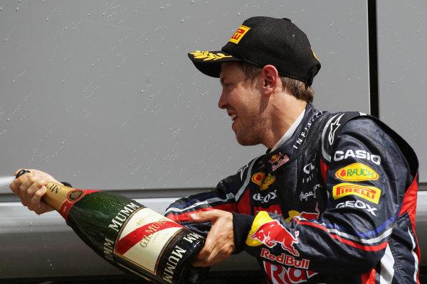 Sebastian Vettel (GER) Red Bull Racing celebrates his second position on the podium. Formula One World Championship, Rd 9, British Grand Prix, Race, Silverstone, England, Sunday 10 July 2011.
