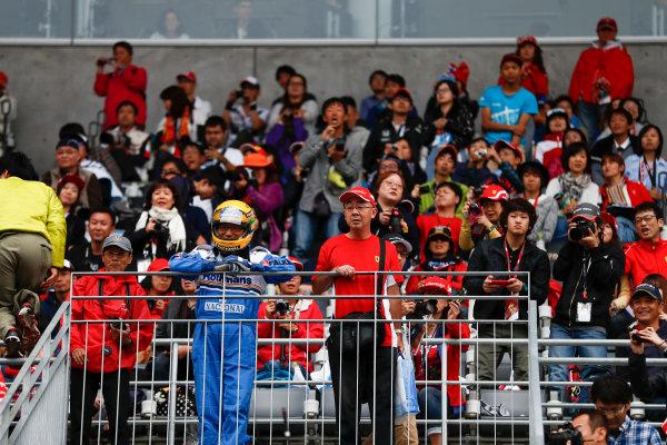 Suzuka Circuit, Japan. Thursday 05 October 2017. A fan in Ayrton Senna costume. World Copyright: Glenn Dunbar/LAT Images  ref: Digital Image _31I4204