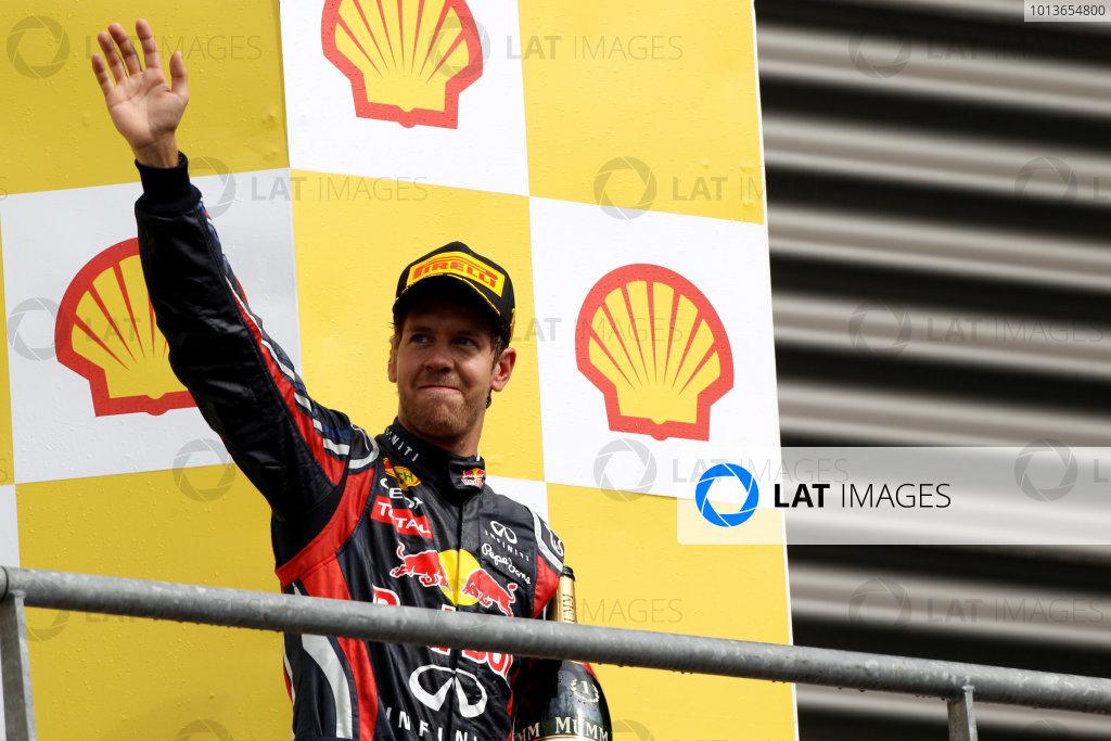 Spa-Francorchamps, Spa, Belgium28th August 2011.Sebastian Vettel, Red Bull Racing RB7 Renault, 1st position, on the podium. Portrait. Podium. World Copyright: Andy Hone/LAT Photographicref: Digital Image CI0C2594