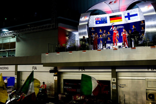 Marina Bay Circuit, Singapore. Sunday 20 September 2015. Sebastian Vettel, Ferrari, 1st Position, Daniel Ricciardo, Red Bull Racing, 2nd Position, and Kimi Raikkonen, Ferrari, 3rd Position, on the podium. World Copyright: Alastair Staley/LAT Photographic. ref: Digital Image _R6T7247