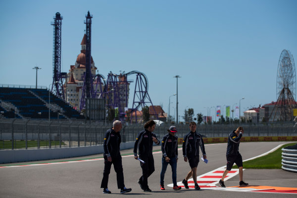 Sochi Autodrom, Sochi, Russia. Thursday 28 April 2016. Carlos Sainz Jr, Toro Rosso, conducts a track walk with team members, including John Booth, who makes his first appearance with the team as director of racing. World Copyright: Sam Bloxham/LAT Photographic ref: Digital Image _R6T2060