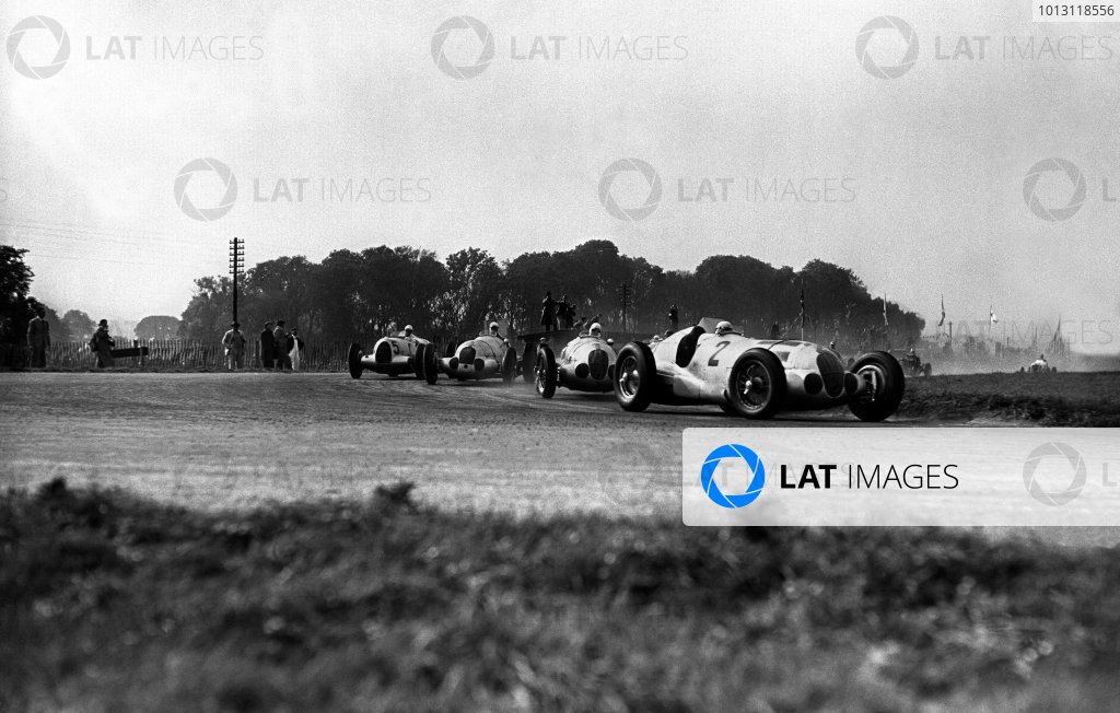 1937 Donington Grand Prix. Donington Park, Great Britain. 2 October 1937. Hermann Lang leads Rudolf Caracciola, Dick Seaman (all Mercedes-Benz W125) and Bernd Rosemeyer (Auto Union C-typ). Rosemeyer, von Brauchitsch and Caracciola finished in 1st, 2nd and 3rd positions respectively. World Copyright - LAT Photographic. Ref: Autocar Glass Plate C13004.