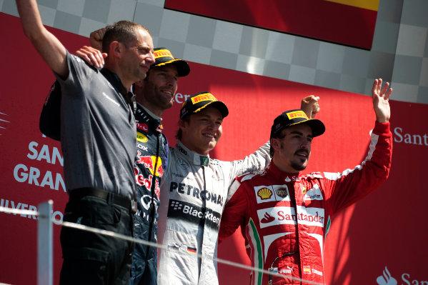 Silverstone, Northamptonshire, England 30th June 2013 Nico Rosberg, Mercedes AMG, 1st position, Mark Webber, Red Bull Racing, 2nd position, and Fernando Alonso, Ferrari, 3rd position, on the podium World Copyright: Chris Bird/  ref: Digital Image _CJB6825