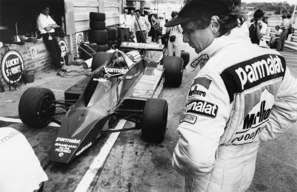 Kyalami, South Africa. 1st - 3rd March 1979. Niki Lauda (Brabham BT48-Alfa), retired, over-looks his car in the pits, portrait. World Copyright: LAT Photographic. Ref: B/W Print.