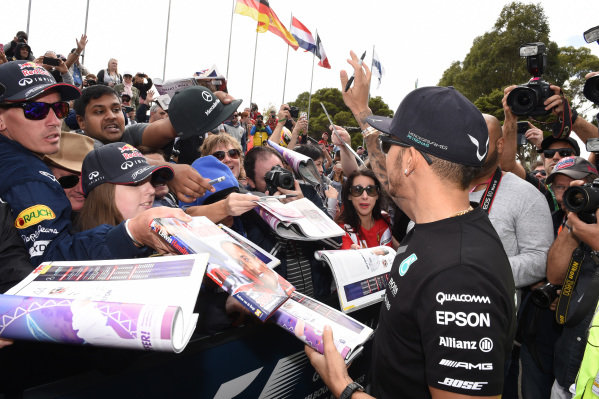 Lewis Hamilton (GBR) Mercedes AMG F1 signs autographs for the fans at Formula One World Championship, Rd1, Australian Grand Prix, Preparations, Albert Park, Melbourne, Australia, Thursday 12 March 2015.