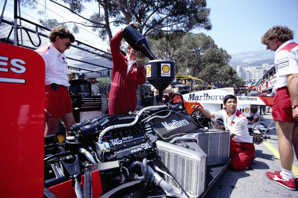 Mechanics refuel a McLaren MP4-3 TAG in the pits.