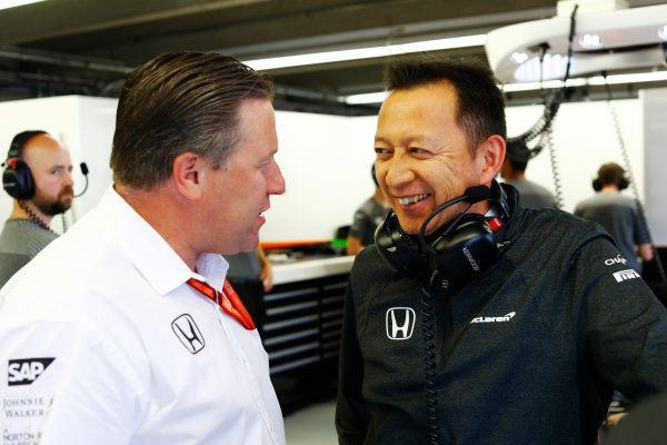Circuit Gilles Villeneuve, Montreal, Canada. Friday 09 June 2017. Zak Brown, Executive Director, McLaren Technology Group, talks to Yusuke Hasegawa, Senior Managing Officer, Honda.  World Copyright: Steven Tee/LAT Images ref: Digital Image _R3I9573