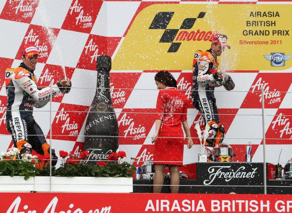 British Grand Prix. Silverstone, England. 10th-12th June 2011. Andrea Dovizioso and Casey Stoner celebrate a Honda 1-2 on the podium.  World Copyright: Kevin Wood/LAT Photographic. ref: Digital Image