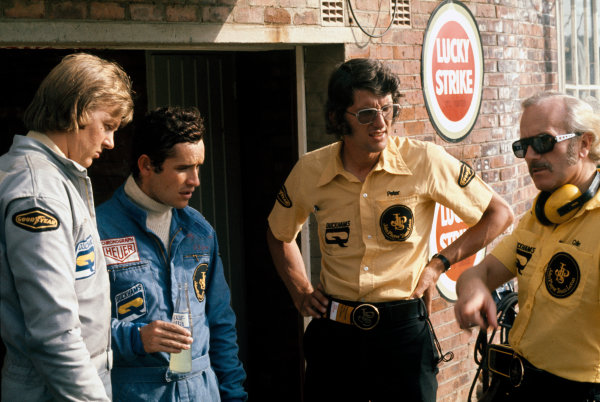 Kyalami, South Africa. 27th February - 1st March 1975. Ronnie Peterson (Lotus 72E-Ford), 10th position, with team mate Jacky Ickx, Peter Warr and team boss Colin Chapman, portrait.  World Copyright: LAT Photographic. Ref: 75SA14