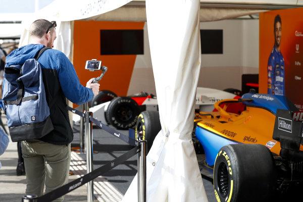 Fans looking at the car of Lando Norris, McLaren MCL35M