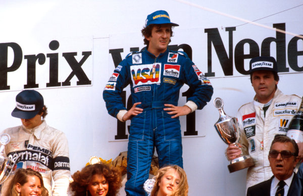 1981 Dutch Grand Prix.Zandvoort, Holland.28-30 August 1981.Alain Prost (Equipe Renault) 1st position, Nelson Piquet (Brabham Ford) 2nd position and Alan Jones (Williams Ford) on the podium. FIA President Jean-Marie Balestre stands in front of Jones.Ref-81 HOL 09.World Copyright - LAT Photographic