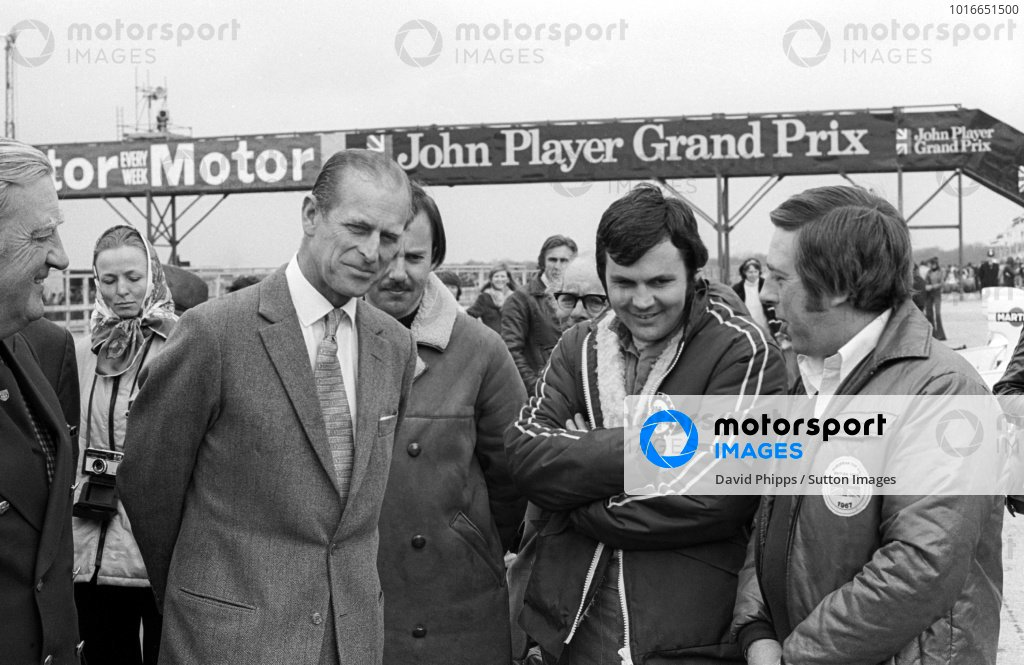 HRH The Duke of Edinburgh (Left) talks with Alan Jones (AUS) Hesketh, who finished the race in seventh position.