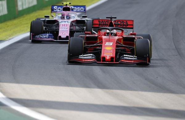 Sebastian Vettel, Ferrari SF90, leads Lance Stroll, Racing Point RP19