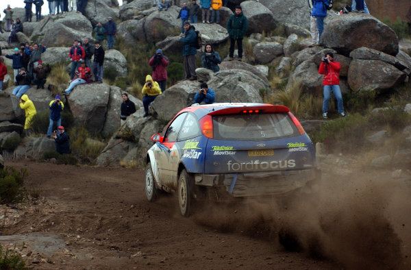 World Rally Championship, Rally of Argentina, May 16-19, 2002.Colin McRae drives through the rocks and spectators on stage 20.Photo: Ralph Hardwick/LAT