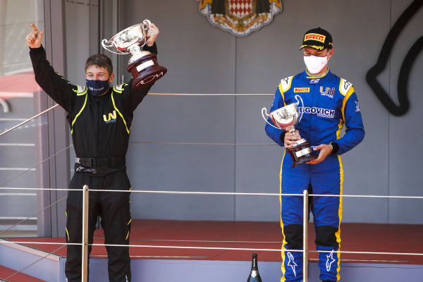 Uni-Virtuosi Racing representative and Felipe Drugovich (BRA, Uni-Virtuosi) celebrate on the podium with the trophy