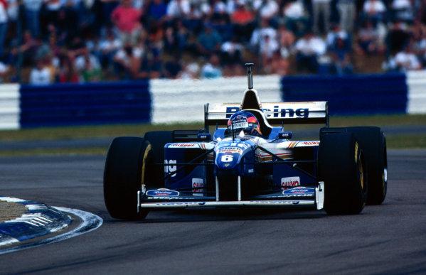 1996 British Grand Prix.Silverstone, England.12-14 July 1996.Jacques Villeneuve (Williams FW18 Renault) 1st position.World Copyright - LAT Photographic