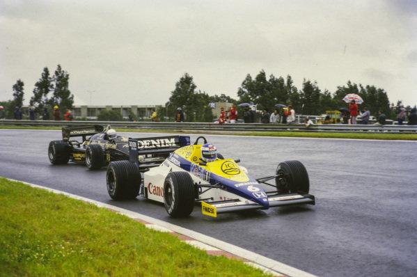 Keke Rosberg, Williams FW10 Honda, leads Elio de Angelis, Lotus 97T Renault.