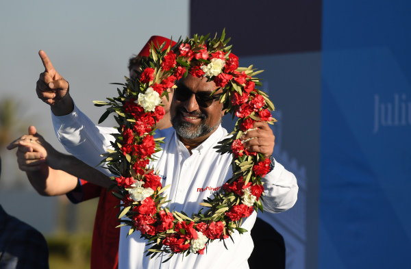 Dilbagh Gill, CEO and Team Principal, Mahindra Racing, celebrates on the podium