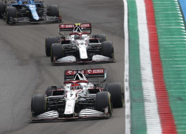 Kimi Raikkonen, Alfa Romeo Racing C41, leads Antonio Giovinazzi, Alfa Romeo Racing C41, and Fernando Alonso, Alpine A521