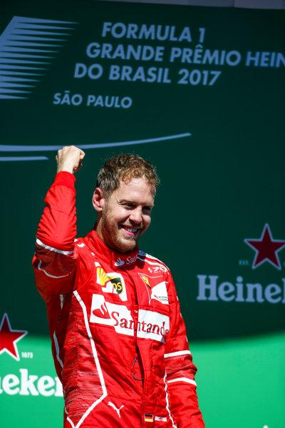 Interlagos, Sao Paulo, Brazil. Sunday 12 November 2017. Sebastian Vettel, Ferrari, 1st Position, celebrates on the podium. World Copyright: Charles Coates/LAT Images  ref: Digital Image AN7T7067